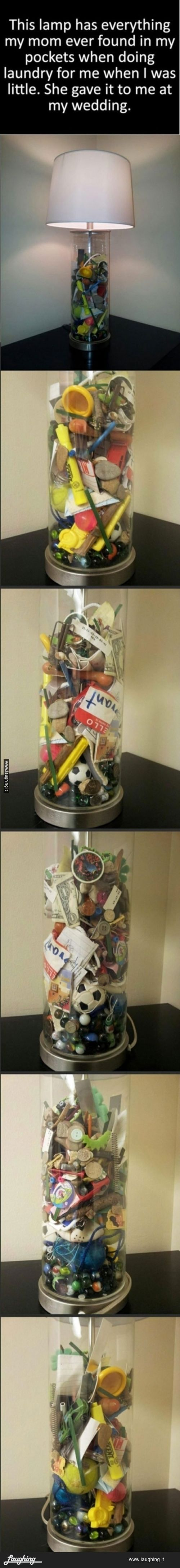Coolest gift ever! A mom saved everything she ever found in her sons pockets and put it all in a clear lamp. She gave it to him as his wedding. This would awesome for a wedding gift or a moving out/going away to college gift.