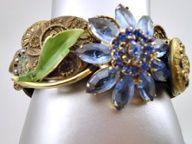 Blue Flower Meets Victorian Bracelet  ooak bracelet that combines Victorian Buttons with a vintage blue glass flower pin. $172, $172