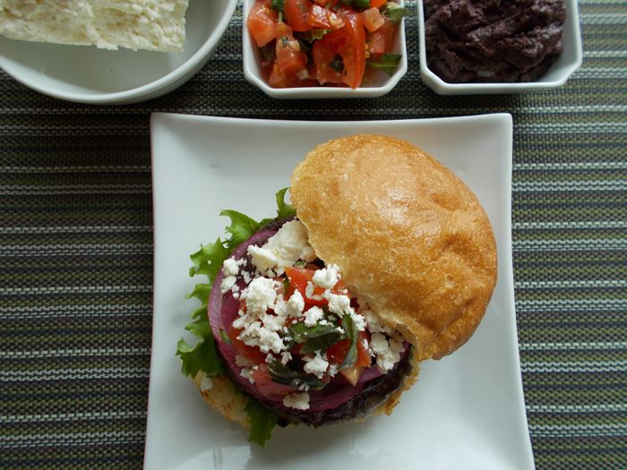 My Mediterranean inspired lamb burger is a great summer recipe to share with friends and family while sipping a nice glass of wine or cold beer. #hamburger #sandwich #great