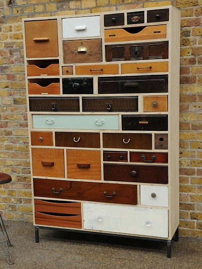 Rupert Blanchard @ Styling and Storage (London) built this treasure.  It was made with 33 drawers (& a bird house) dating from 1860's-1970's. It took him 3 yrs. to gather the drawers from many pieces of furniture including desks, wardrobes, bureaus, filing cabinets, etc. from junk shops, markets & dealers all across the uk.  This big boy would hold a lot of craft supplies.