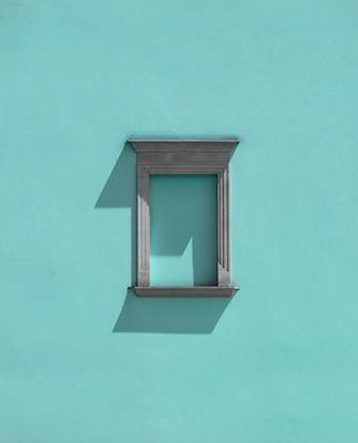 A window that is no longer there on a blue wall. Lovely minimalistic photograph by Marcus Cederberg. Available as poster at printler.com, the marketplace for photo art.