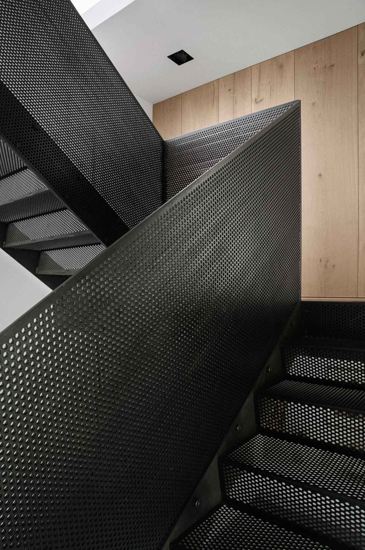 Perforated black steel balustrade | stairs | design | Peter's House in…