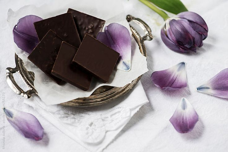 layout a simply lovely festive tray of (organic) dark chocolate & edible Spring tulip/flower petals...
