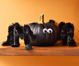 Paint pumpkins black; let dry. Apply black pipe cleaners to each side, bending them to form legs. Glue googly eyes to the front.