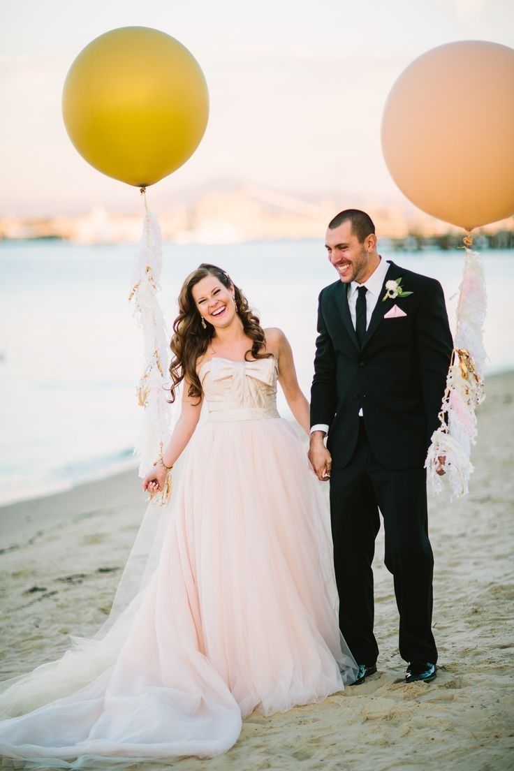 Wedding Photography Inspiration : bride groom and some giant balloons on the beach