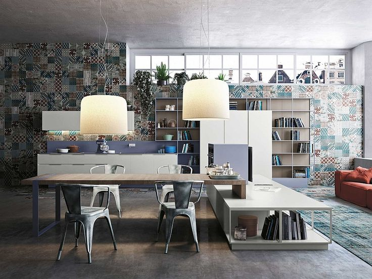 Lovely pendant lights add to the aura of the kitchen Fluid And Fashionable Kitchen Compositions Offer Deft Modular Storage Solutions