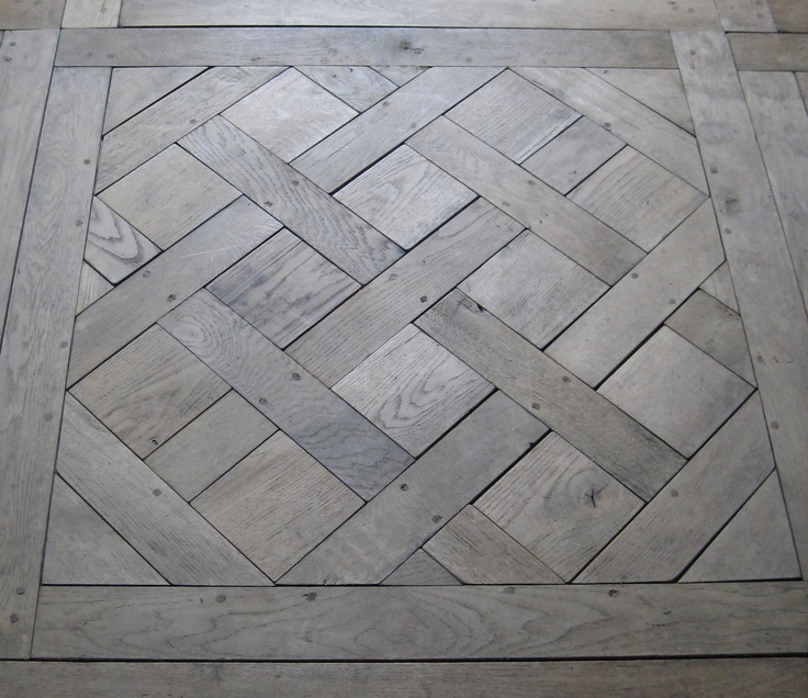 Parquet de Versailles. Love the colour of this timber floor. Aged, grey. Beautiful.