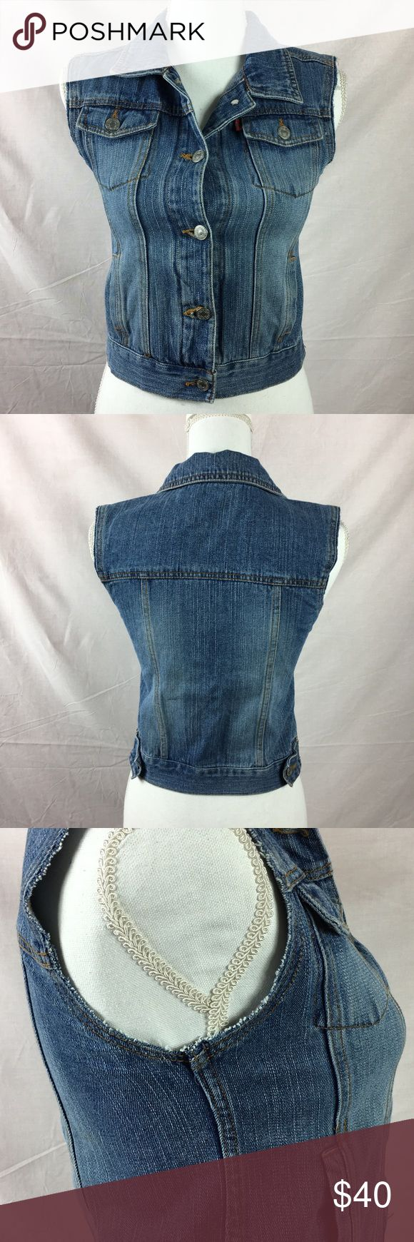 """Levis Denim Blue Jean vest cut off sleeves Levi's Denim Blue Jean vest with cut off sleeves. In great condition. 16"""" from armpit to armpit. 18"""" from top of Shoulder to bottom of vest. Levis Jackets & Coats Vests"""