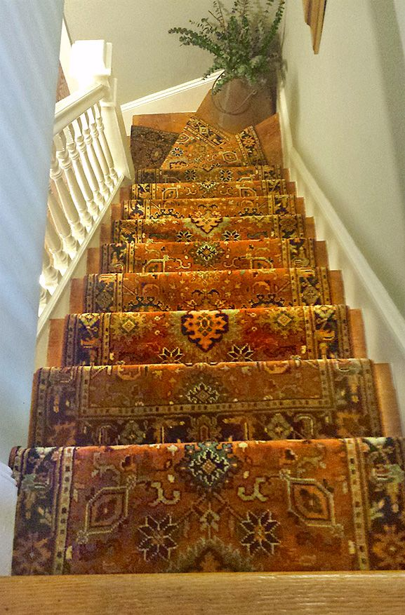 It really depends on the width of the staircase, but the average amount of wood I like to see is 3-4″ but it can be as little as 1″ but really probably not much more than 6-8″ .......nejad.com staircase-rug-runner