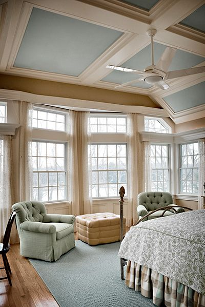 Love the colors in the coffered ceiling and the wall of windows.