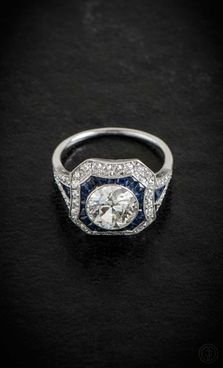 A Stunning Diamond And Sapphire Engagement Ring Set In Platinum And With  Two Halos Surrounding