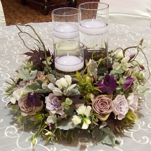 Centerpiece with a trio floating candles surrounded by