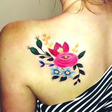 Flowers on Shoulder Blade Tattoo Idea