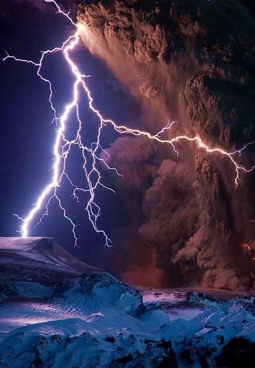 Lightning veins the Eyjafjallajökull volcano's ash plume.