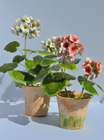 Hand Made Pink Geranium.  Porcelain Flowers and Pot.  Tole Leaves and Stems.  10 1/2 x 8 1/2.
