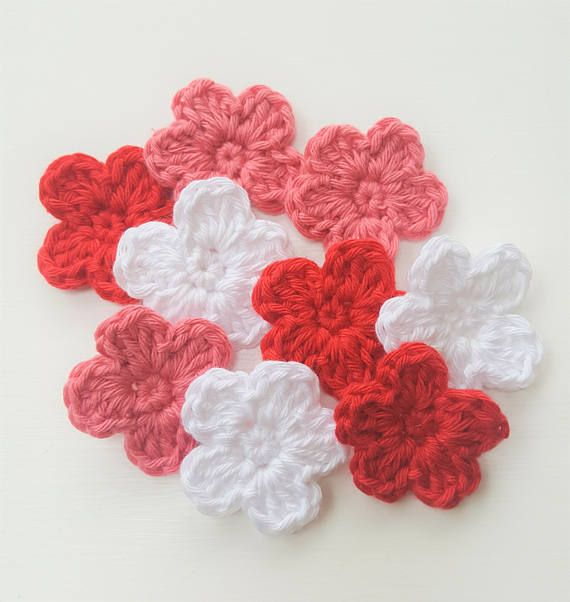 9 small crochet flowers, crocheted by hand in 100% cotton yarn. 3 in each colour: dusty pink, orange and white  Approx size: 4cm wide/1.5in wide  These little flowers are ideal to embellish a wide array of items: hair accessories, brooches, sewing projects, scrapbooking, cardmaking, blankets and many others.  Custom Orders: If you would like these to be made in different colours or quantities, please contact me to discuss.