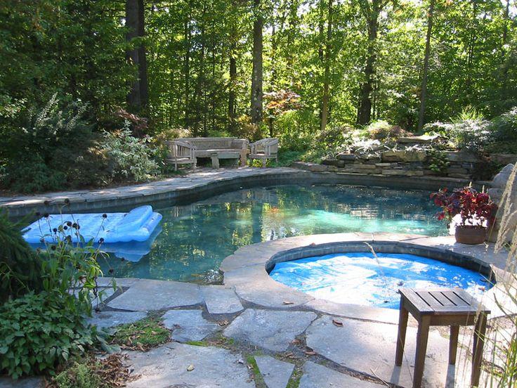 Captivating Flagstone Patio Surrounding Pool And Hot Tub