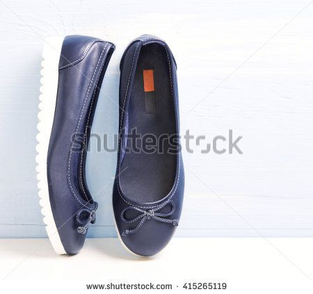 Lace blue leather slippers loafers modern style shoes closeup. Female sport design lady's ballerinas.