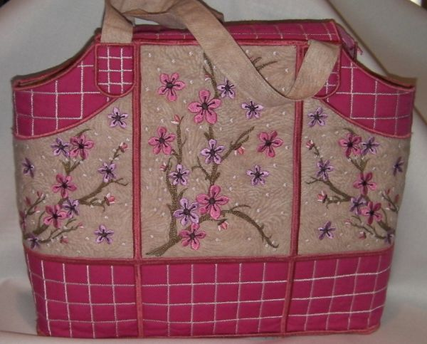 In the hoop Cherry Blossom Bag - Created by JHB Creations and done on your embroidery machine.  Designs for purchase to make such a bag from OPW Mall http://www.oregonpatchworks.com/items.php?did=113482&pid=1599372