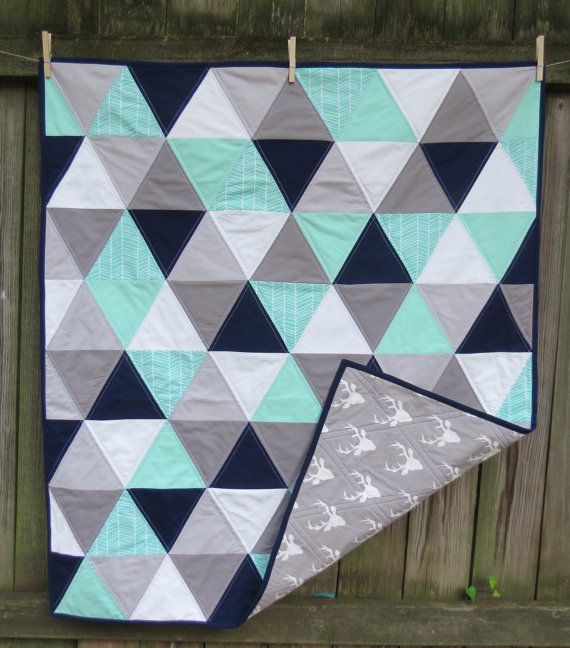 Mint, navy, grey and mint baby quilt with deer by Twin City Quilt Co. twincityquiltco.com Available for purchase via request.