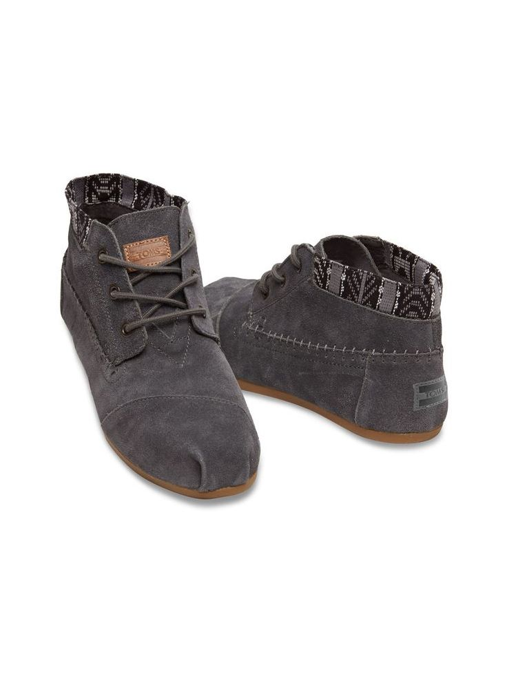 The holidays are a busy time. Hop to it in TOMS women's Dark Grey Trim Suede Tribal Boots. Whether you wear them now, or open them later they'll be your casual go-to shoe for all seasons.