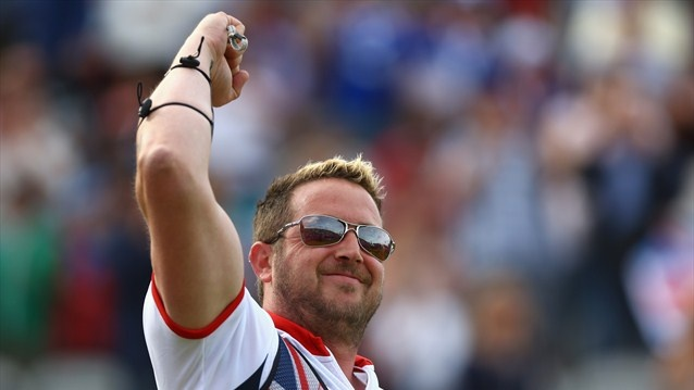 Larry Godfrey of Great Britain celebrates winning his men's Individual Archery 1/32 eliminations match against Juan Rene Serrano of Mexico on Day 3 of the London 2012 Olympic Games at Lord's Cricket Ground.