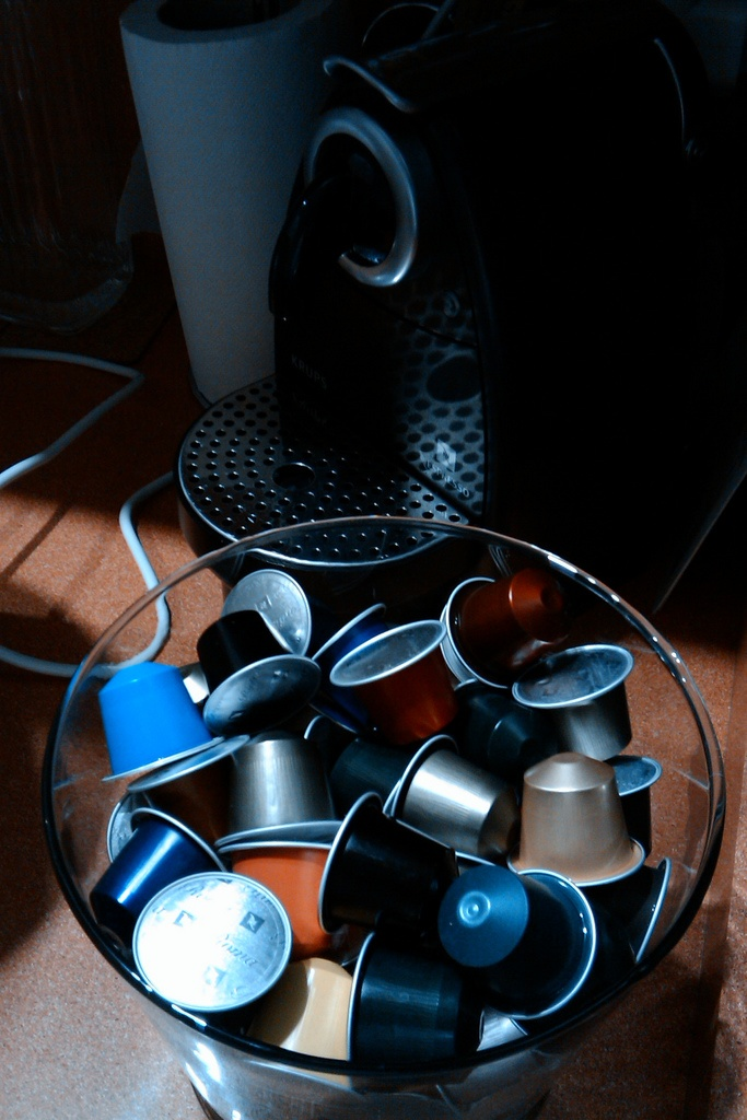 Nespresso and other cofee systems based on capsules.  Wasted alumninium (supposedly recycled... mwha hahaha), very expensive, unfair trade, povertry for producers, style, affordable luxury, fast food... What else?