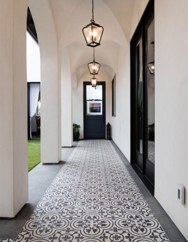 Granada Tile's classic Cluny tiles draw the eye down this long Moorish-inspired patio walkway.