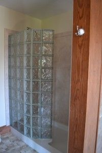 Learn how to eliminate a Shower Door with a Low Maintenance Glass Block Walk in Shower Kit in this Lincoln Delaware project. This project also used a low maintenance stone like shower wall surround kit as well. http://innovatebuildingsolutions.com/products/glass-block/glass-block-shower #glassblockshower