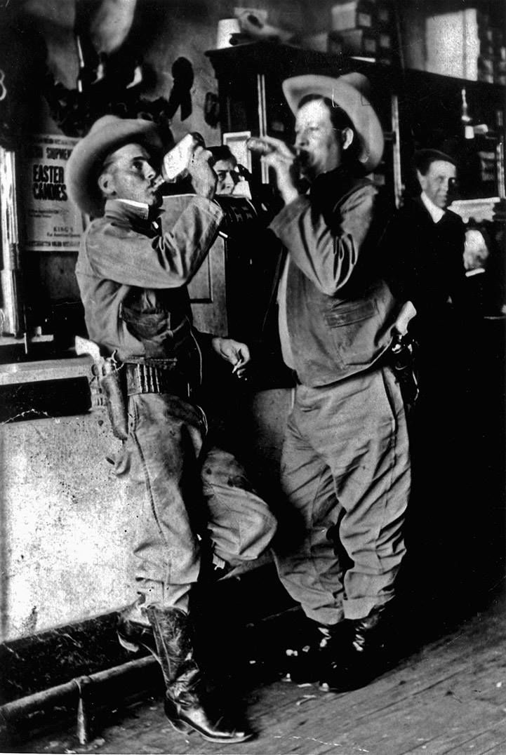 Texas Rangers, Nate Fuller and A.G. Beard drinking in a bar, 1918. This was most likely taken in Marfa.