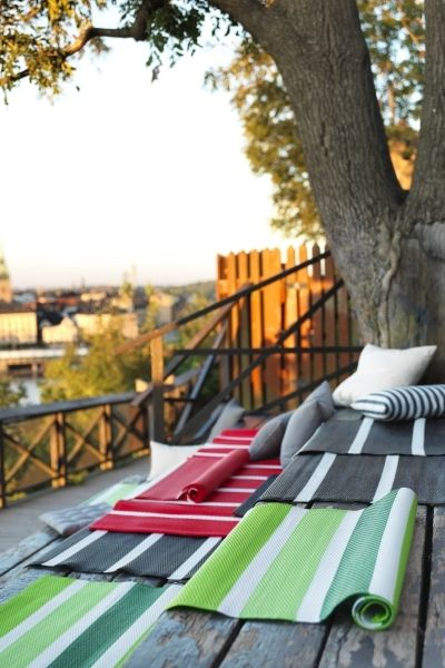 Use Outdoor Rugs As Seating Pads For All The Fun Viewing Events This Summer From