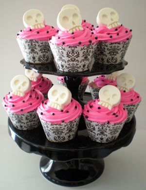 Cupcakes - the skulls look goofy, if we can find pretty black and white ones that would be cool.