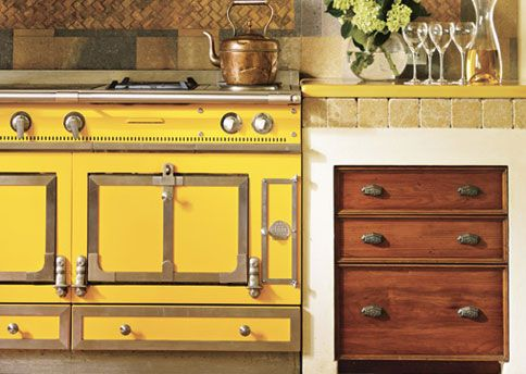 Stove Love - A yellow La Cornue stove is the modern-day hearth. With its handmade fittings, snug ovens, and cast-iron flat top, this enameled French range is a state-of-the-art version of what French chefs have been using for more than 100 years.