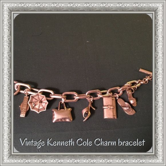 Vintage Kenneth Cole Charm bracelet Vintage Kenneth Cole toggle charm bracelet very heavy, hallmark & not sure if it is Sterling silver! Kenneth Cole Jewelry Bracelets