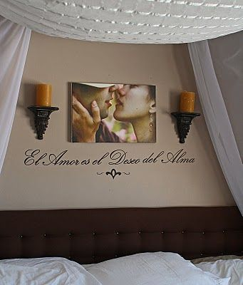 Love this arrangment for over my bed since we have no headboard, however, I don't know what that says lol