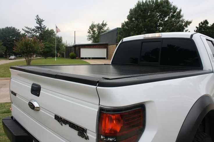 White Ford Raptor with hard tonneau cover