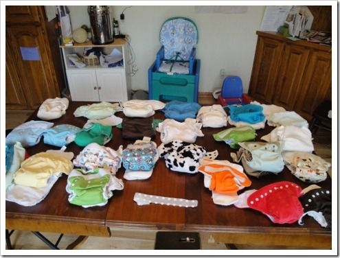 This lady reviews 24 different kinds of cloth diapers first hand. Has pictures, videos, etc. Very informative!