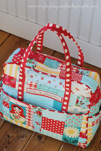 Amy Butler pattern.  The finished project is shown on linked page.  Love the design from the patchwork.  Beginning post is at http://www.mommybydaycrafterbynight.com/2012/10/wip-quilted-patchwork-weekender-bag.html.