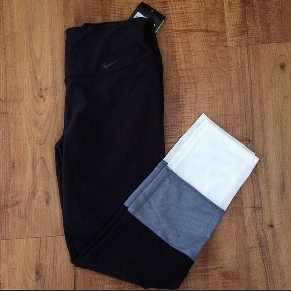 NWT Rare Nike Leggings Rare NWT Nike leggings. White part is mesh as shown. Longer cropped length, almost full length. I've never seen anyone else with these before, so unique!! CAN SELL ON ♏️ERCARI FOR LESS Nike Pants Leggings