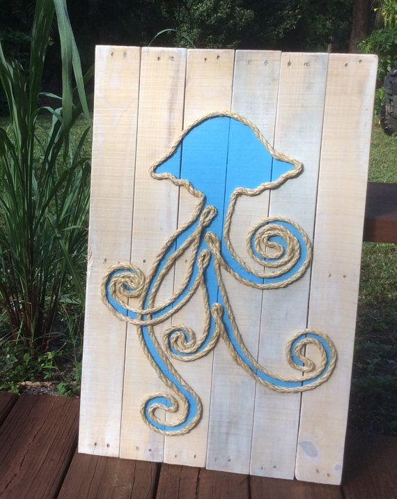 This beachy piece of art is made from reclaimed pallet wood and is perfect for a nautical inspired beach house! Each sign is hand cut, hand