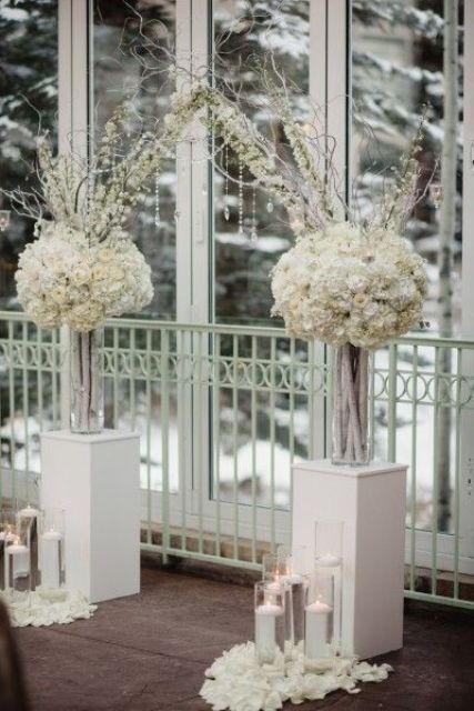 30 Winter Wedding Arches And Altars To Get Inspired: #12. White floral arch with floating candles and petals for winter wonderland weddings