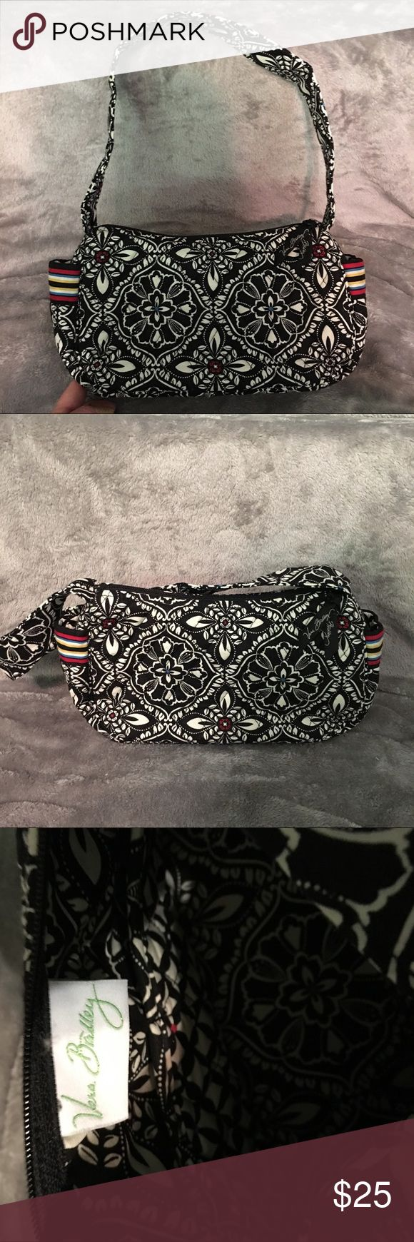 New without tags Vera Bradley black and white bag Never used retired pattern black and white flowers with red and blue middles .Beautiful pattern Vera Bradley Bags Shoulder Bags