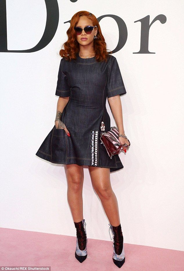 VIP: Rihanna hit Dior's Autumn Winter 2015 show at the National Art Center in Tokyo on Tuesday in her new role as the face of the design house.