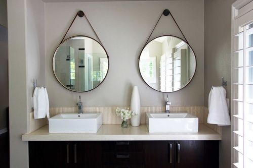 boxwoodclippings_round mirrors in bathroom