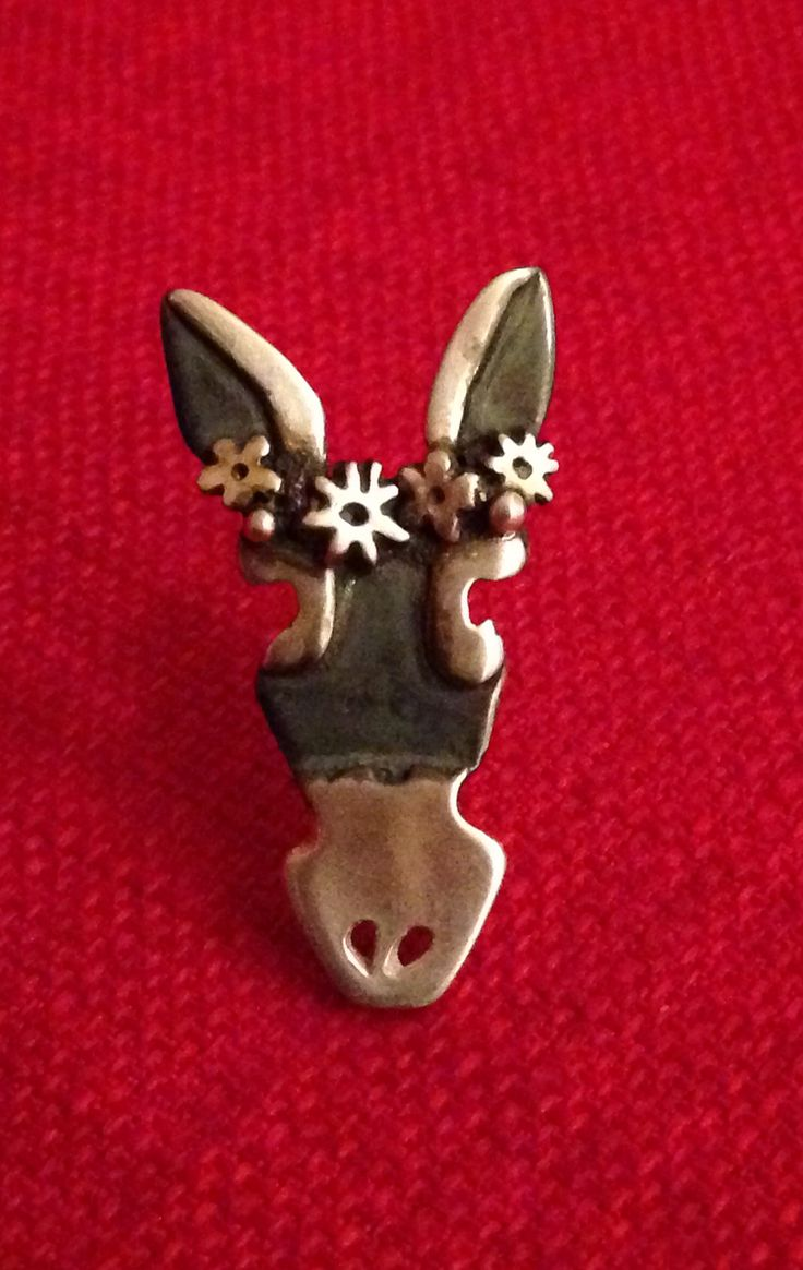 Silver donkey brooch hand made by Helen Green from silver sheet, silver clay and oxidised with liver of sulphur.