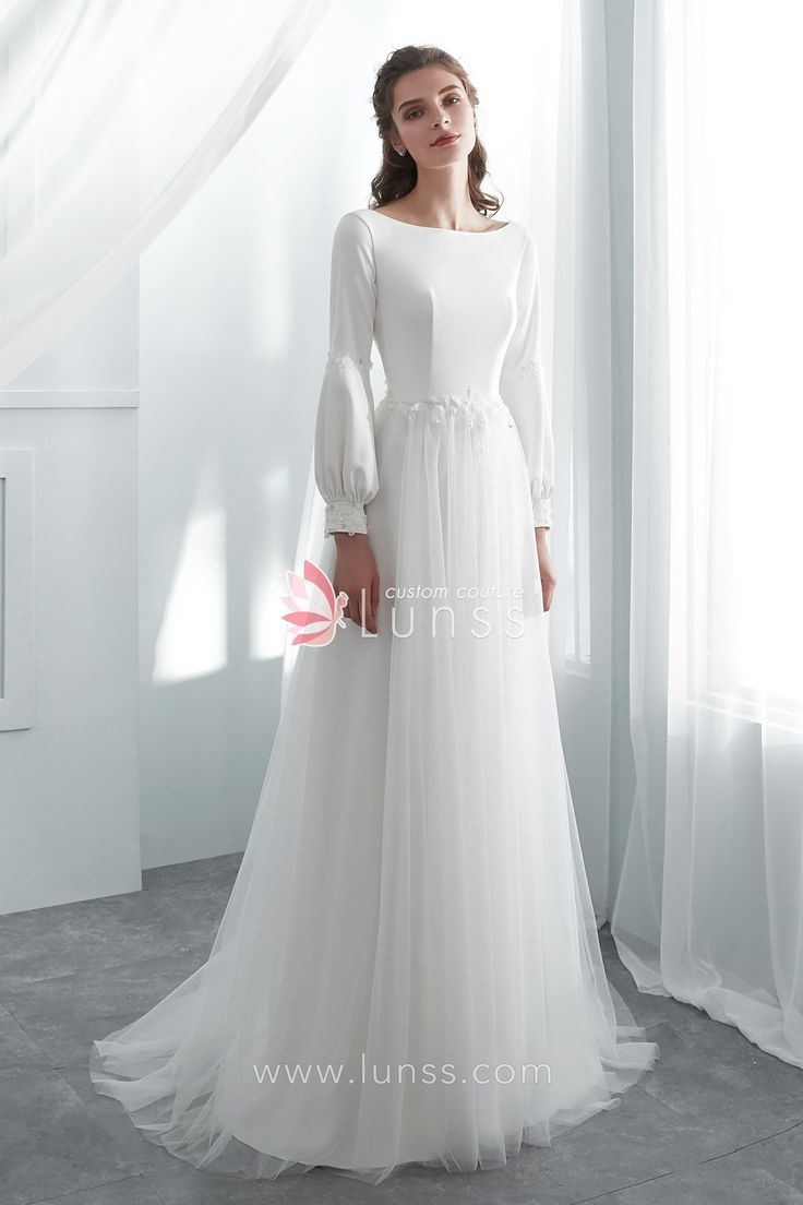 This ivory boho A-line wedding dress features simple bodice with jewel neckline