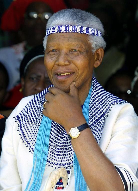 Nelson Mandela, wearing traditional Xhosa dress, attends the wedding of his great grand nephew on December 7, 2002 in Umtata, Eastern Cape P...