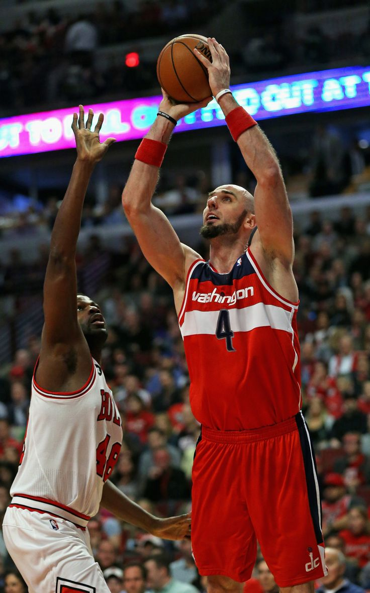 CHICAGO, IL - APRIL 22: Marcin Gortat #4 of the Washington Wizards shoots over Nazr Mohammed #48 of the Chicago Bulls in Game Two of the Eastern Conference Quarterfinals during the 2014 NBA Playoffs at the United Center on April 22, 2014 in Chicago, Illinois.