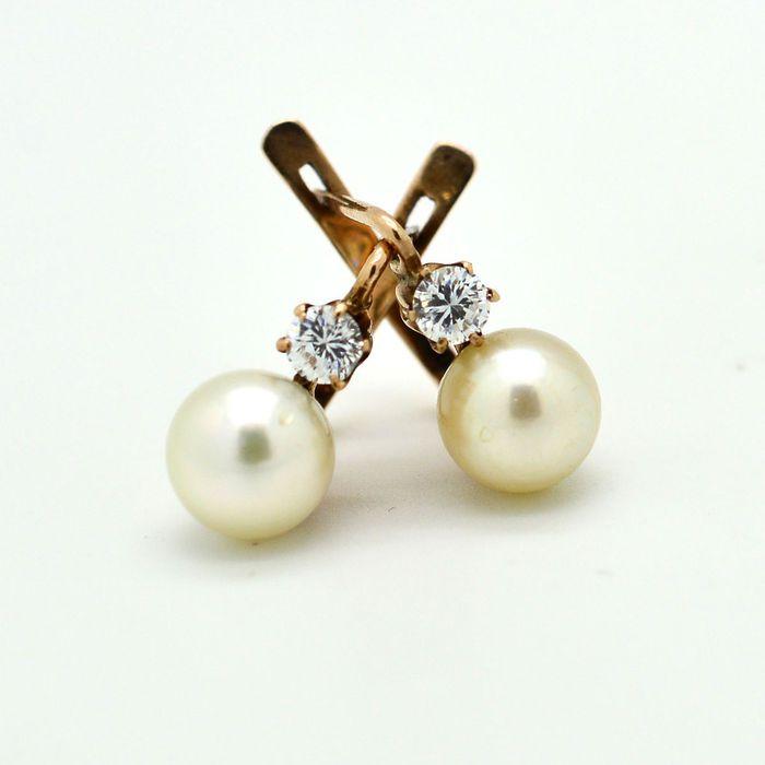 Online veilinghuis Catawiki: Antieke oorbellen met parels en diamanten.