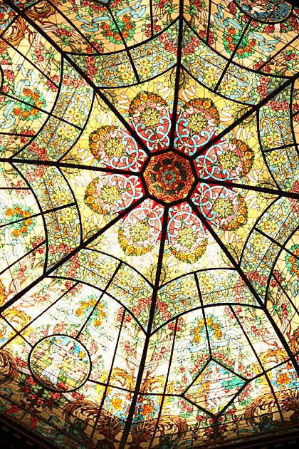 "Description said: ""Glass Ceiling: Teatro Colon."" I was sure it wasn't Gaudi's but need to do some research before I pinned it. Teatro Colon is in Buenos Aires, and Gaudi never crossed the Atlantic... If someone knows the name of the stained-glass designer I'll appreciate it. And if some can confirm that's Teatro Colon in Buenos Aires, I'll appreciate that too! Thanks!"